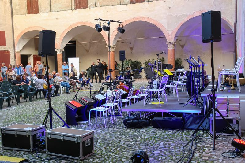 People near prepared concert stage on festivities in historic ce stock image