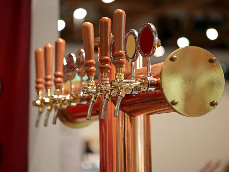 Spiles for dispensing of draft beer in a night pubs. Spiles for dispensing of draft beer in a night exclusive pubs stock image