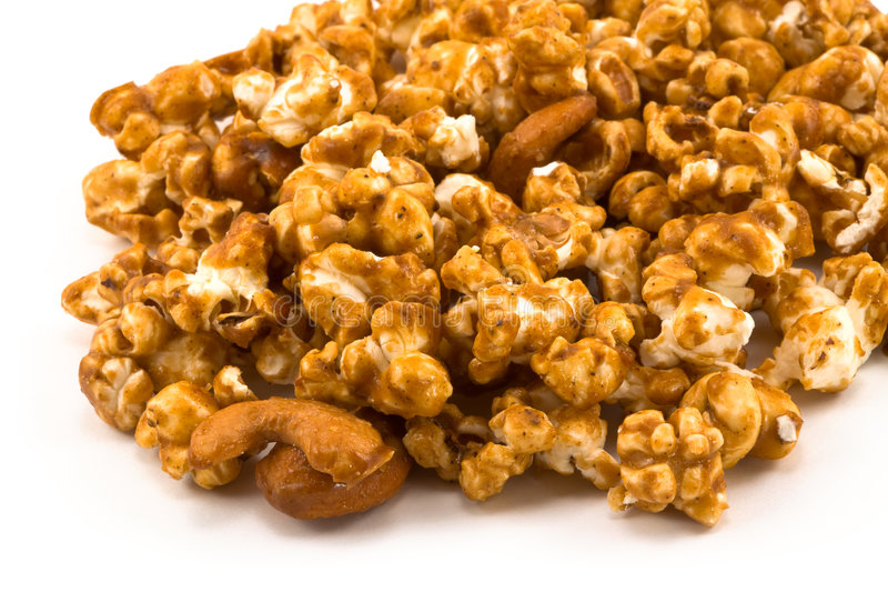 Spill of Golden Caramel Corn on White. Background royalty free stock photo