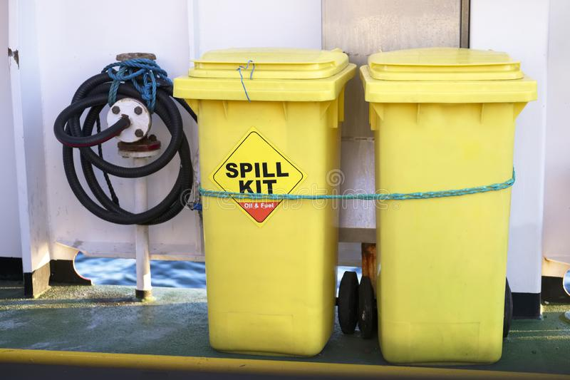Spill kit yellow wheelie bin for health and safety of chemical, oil, diesel or petrol leak. Uk royalty free stock photos