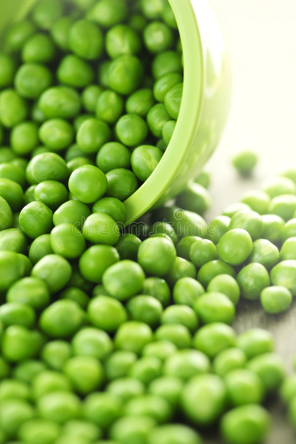 Free Spilled Bowl Of Green Peas Stock Photo - 16043380