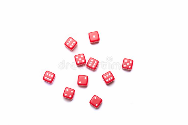 Spilled Dice on a white studio background. Ten dice spread out on on a white background in the studio stock image