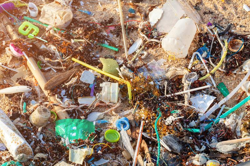 Spilled garbage on the beach. Empty used dirty plastic bottles.  Dirty sea, sandy coast the Black Sea. Environmental pollution. stock photos