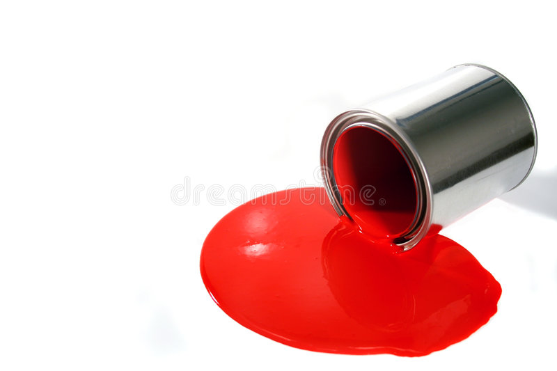 Spilled paint pail. A spilled red paint bucket royalty free stock images