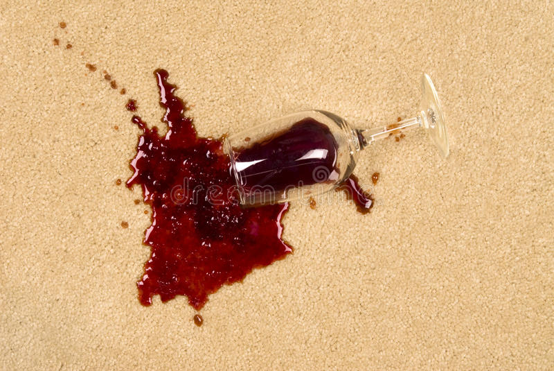 Spilled wine on carpet royalty free stock photography