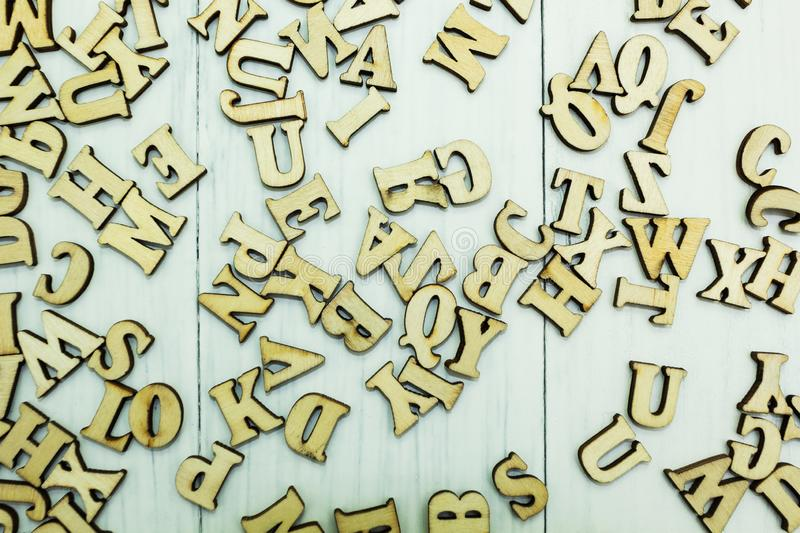 Spilled wooden letters on a white wooden background royalty free stock photos