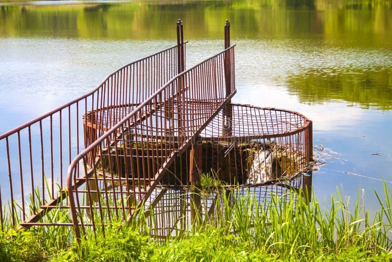 Spillway on the forest lake. Goloseevo, Kiev, Ukraine royalty free stock photos