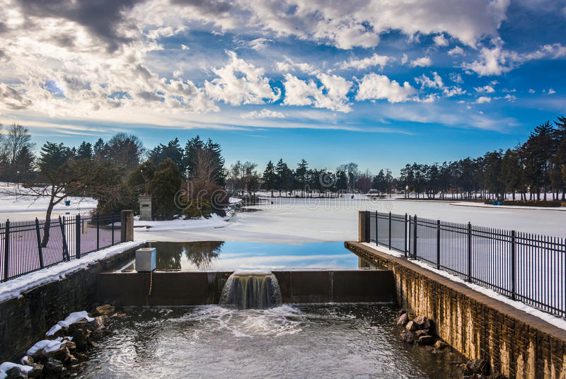Spillway at Kiwanis Lake, seen during the winter in York, Pennsylvania. stock photography