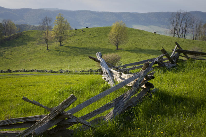 Spilt rail fence crosses mountain pasture. stock image