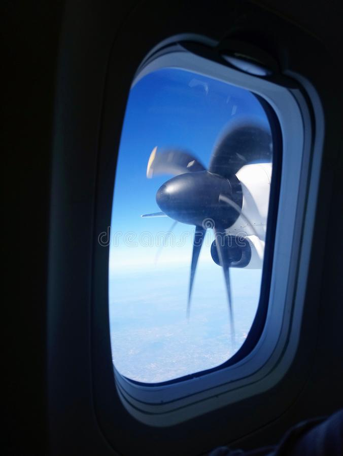 Spin wing see through the airplane windows royalty free stock photos
