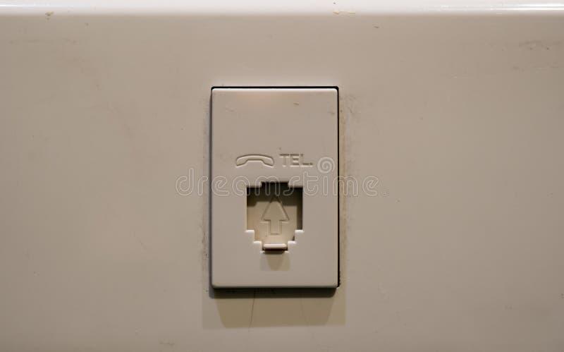 Spina di parete del telefono con il logo smussato fotografia stock libera da diritti