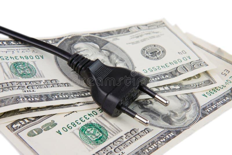 Spina elettrica e soldi fotografie stock libere da diritti