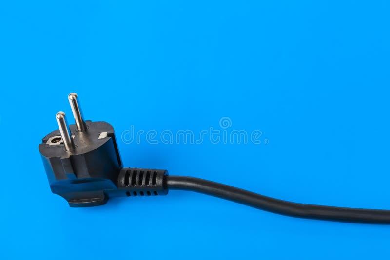 spina elettrica su fondo blu fotografia stock
