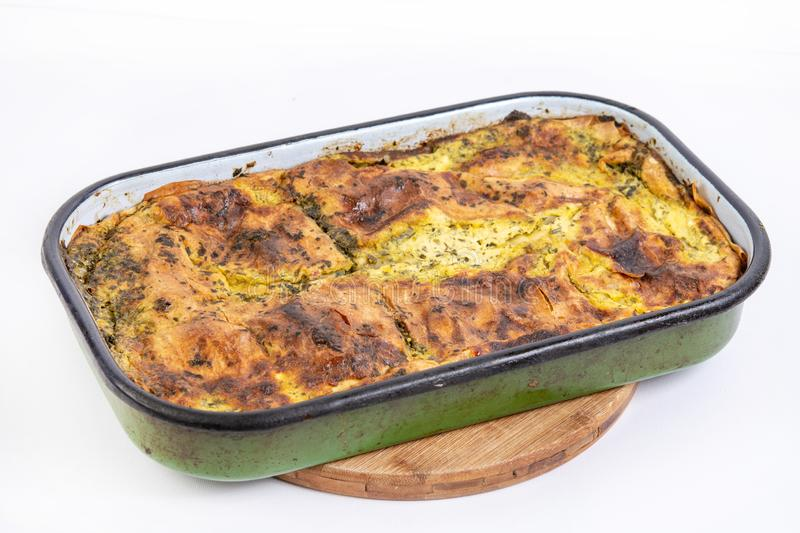 Spinach and cheese pie baked and served on the table stock photography