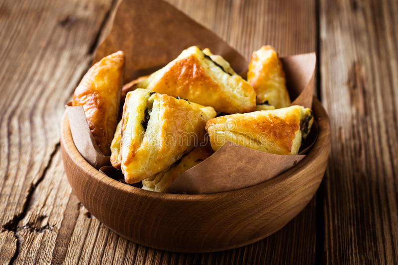 Spinach and cheese puff pastries stock photo