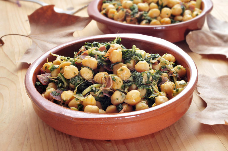 Spinach with chickpeas. Spanish espinacas con garbanzos, spinach with chickpeas, served as tapas royalty free stock image