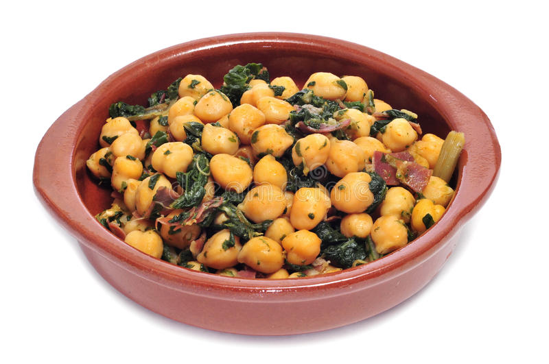 Spinach with chickpeas. Spanish espinacas con garbanzos, spinach with chickpeas, served as tapas on a white background royalty free stock photos