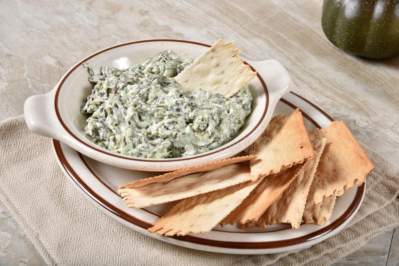 Spinach dip and artisan crackers royalty free stock images