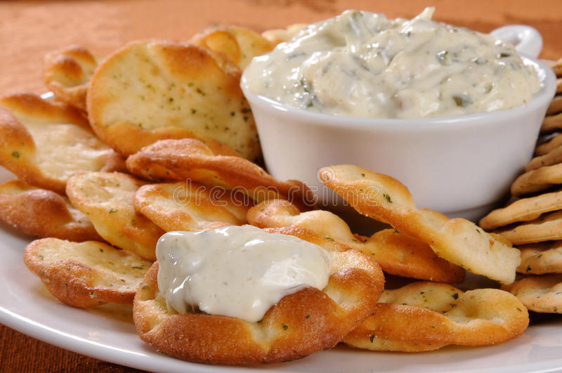 Spinach dip and crackers stock photo