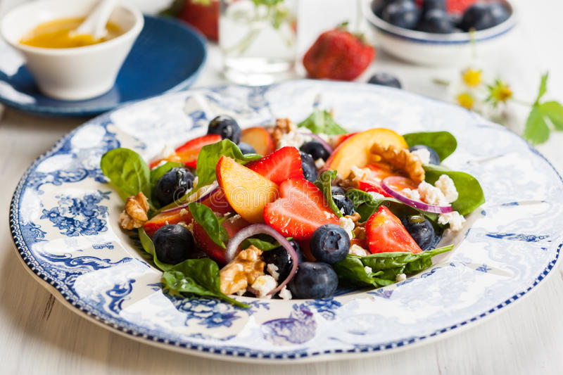 Spinach and Fruit Salad stock images