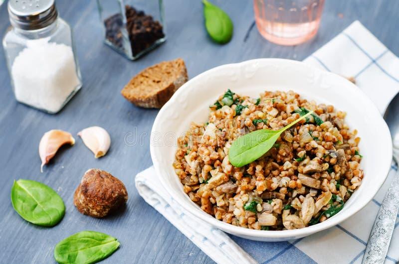 Spinach, mushrooms buckwheat stock image