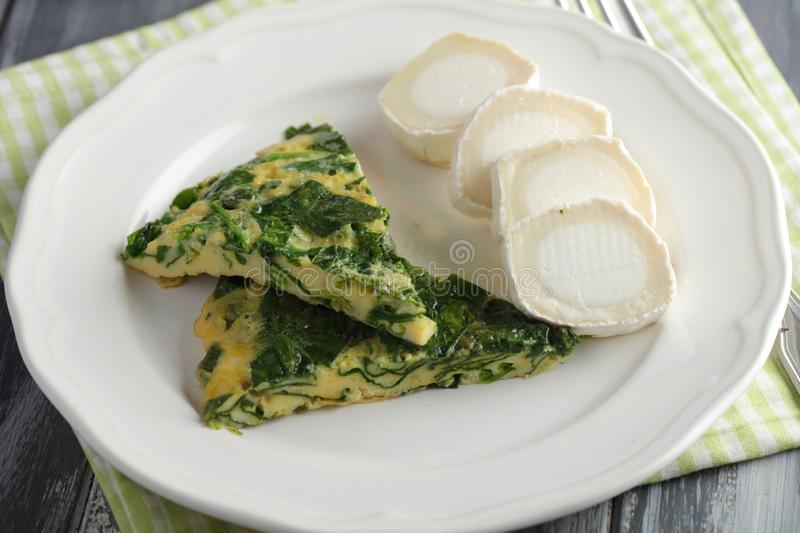 Spinach omelet and goat cheese roll. Healthy spring breakfast royalty free stock images