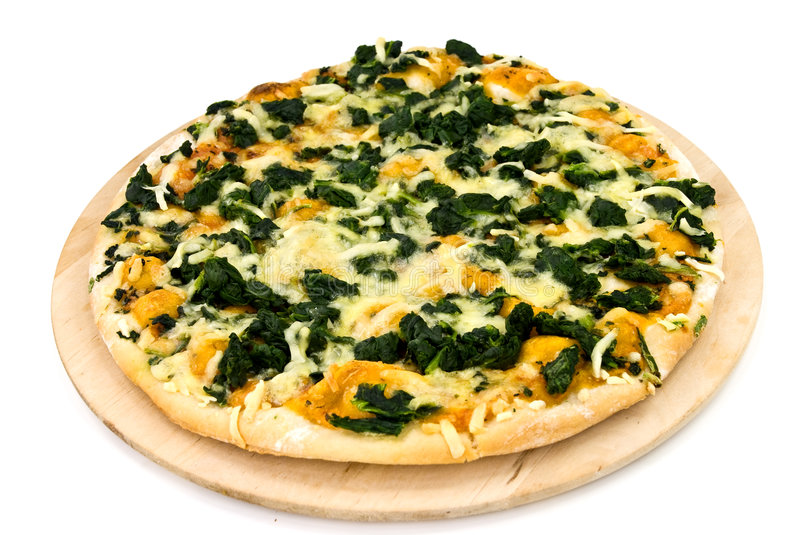 A spinach pizza with mozzarella cheese,spices royalty free stock photo