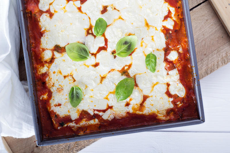 Spinach, ricotta and bacon lasagna stock images