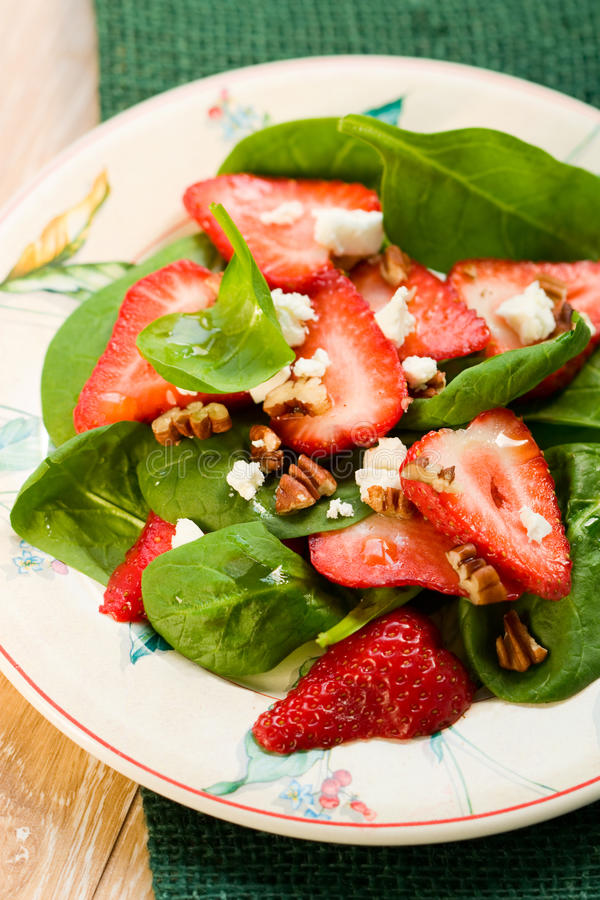 Spinach salad with strawberries royalty free stock photo