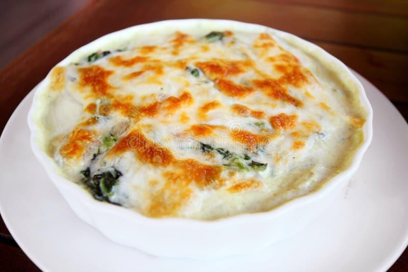 Spinaci cotti con formaggio fotografia stock libera da diritti