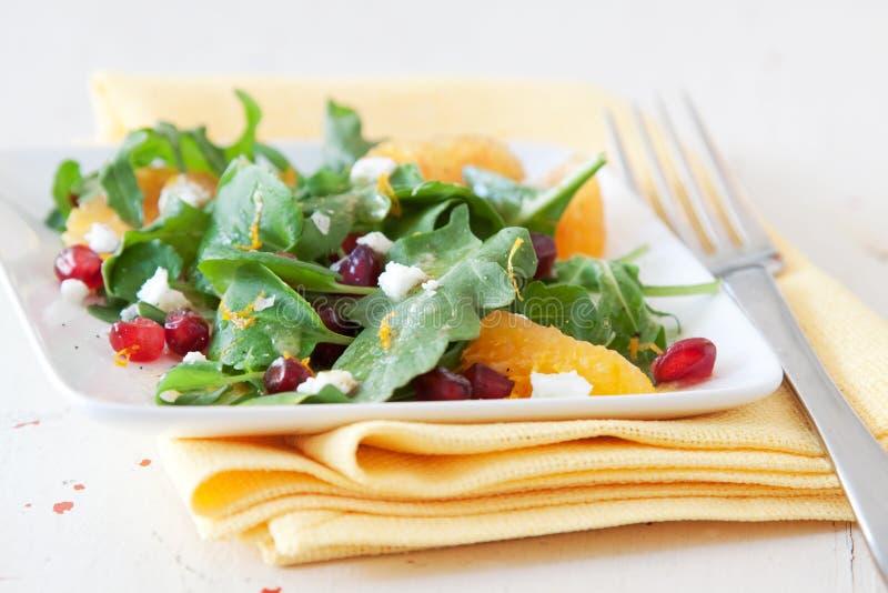 Spinaci, melograno ed insalata arancione immagini stock