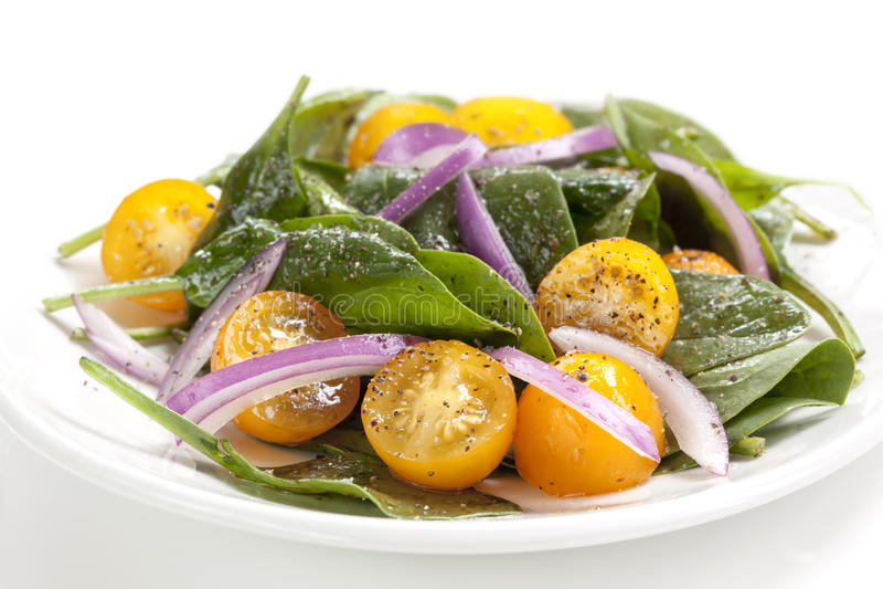 Spinats-und Tomaten-Salat stockbilder