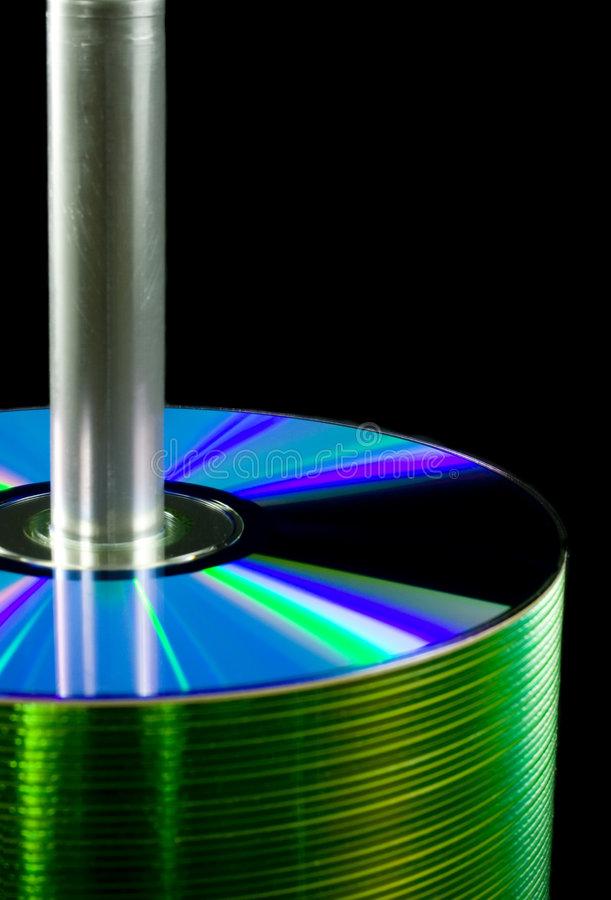 Spindle of CDs. Closeup of a spindle of CDs isolated on white background stock image