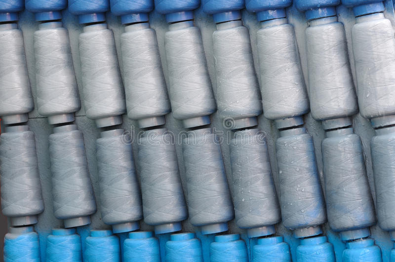 Spindle design. Different color spindle repeated pattern, gray, sliver and blue, means industry, regular and alignment or consistent royalty free stock images