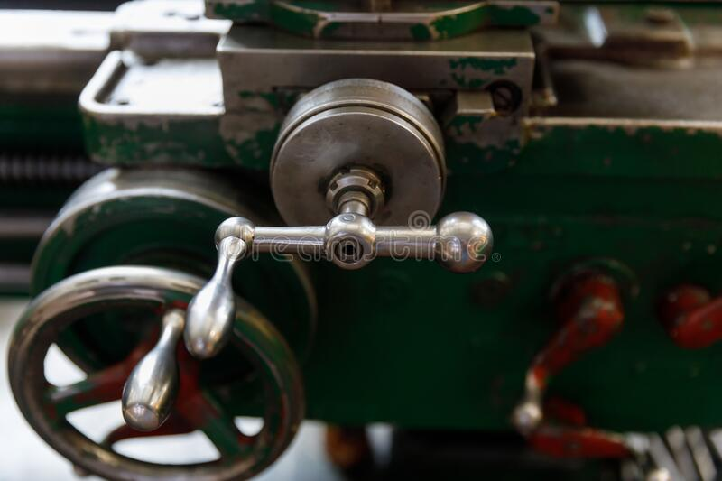 Spindle, tool holder and old green lathe machine tool equipment royalty free stock images