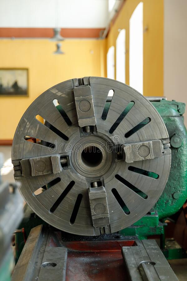 Spindle, tool holder and old green lathe machine tool equipment stock image