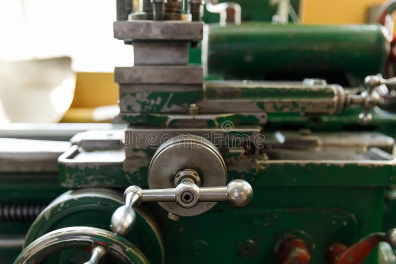 Spindle, tool holder and old green lathe machine tool equipment stock photo