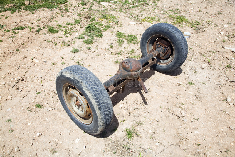 Spindle wheels. Old car spindle with two wheels at the country stock photos