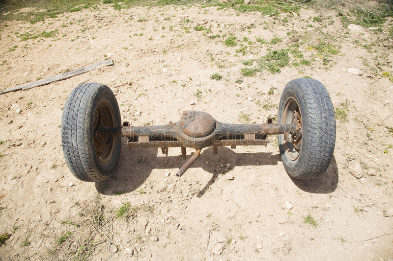 Spindle wheels front. Old car spindle with two wheels at the country stock photography