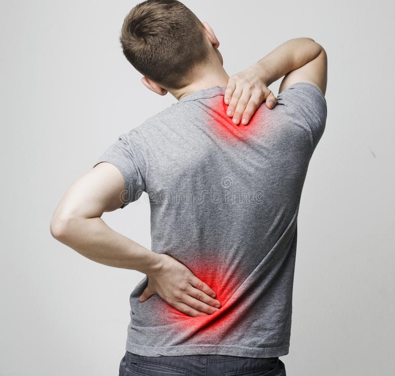 Spine osteoporosis. Scoliosis. Spinal cord problems of man. Spine osteoporosis. Scoliosis. Spinal cord problems on man`s back royalty free stock photography