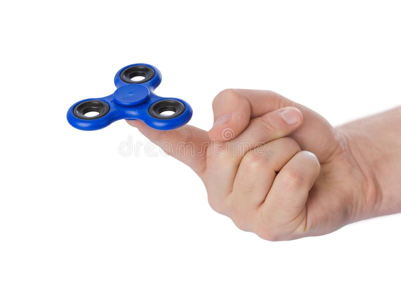 Spinner in der Hand lizenzfreie stockfotografie