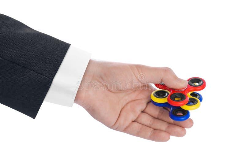 Spinner in der Hand lizenzfreies stockfoto