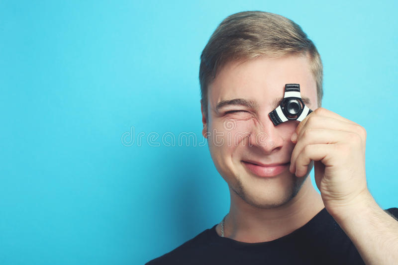 Spinner. The guy is playing with a spinner on a blue background stock photo