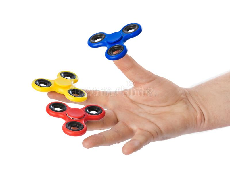 Spinners in hand stock photography