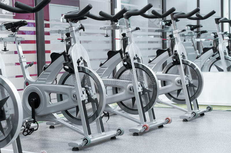 Spinning bikes royalty free stock images
