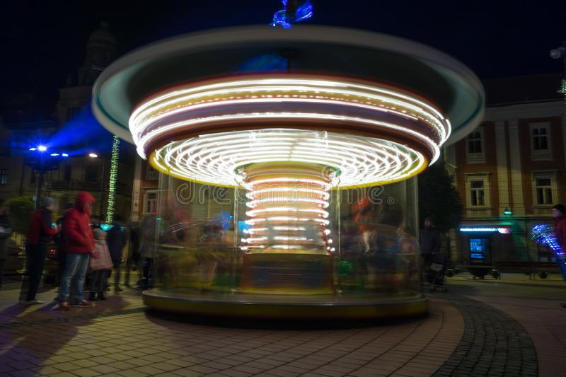 Spinning carousel for kids. View of a spinning carousel for kids. Night scene. Long exposure stock photos