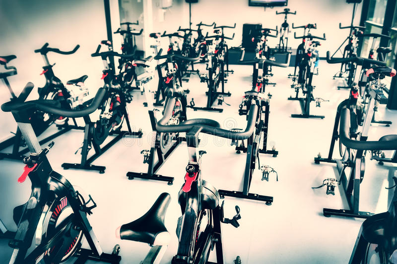 Spinning class with empty bikes royalty free stock photography
