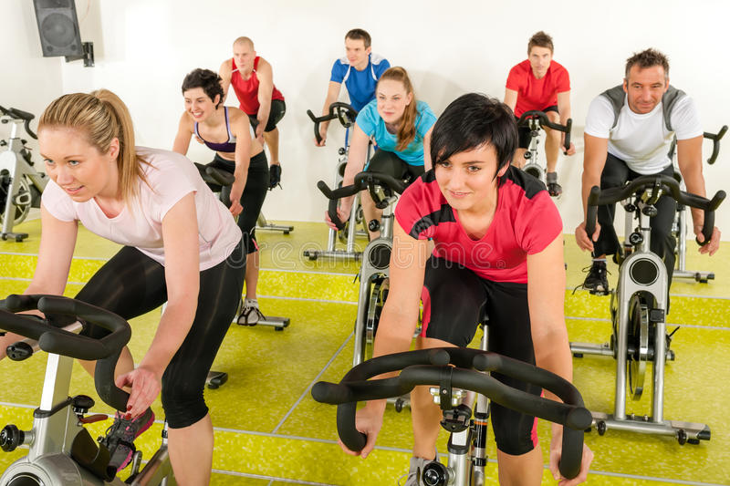 Spinning class people at the fitness center stock image