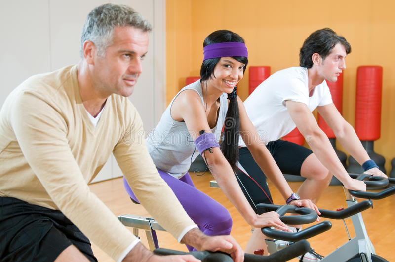 Spinning Excercise Group At Gym Stock Photography