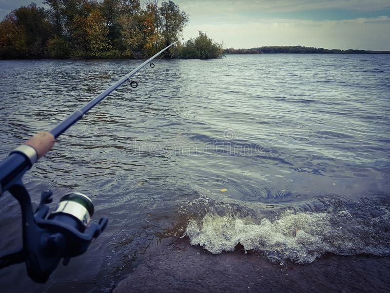 Fishing spinning on the river stock images